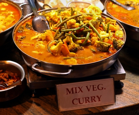 Mix vegetables curry sold as fast food on market Stock Photo