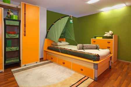 bedroom bed: Green child bedroom interior with camping theme