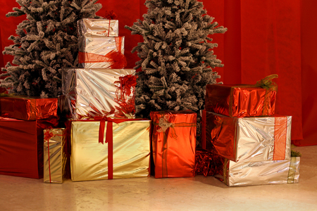 Christmas gifts under the tree inside home photo