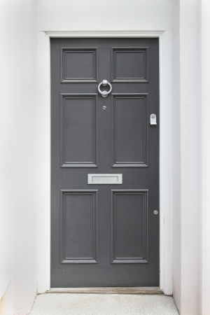 Gray entrance door to front of residential house Stock Photo