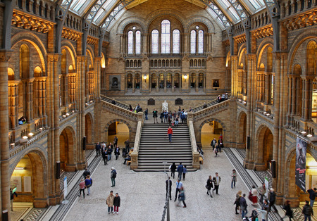 Famous London Natural History Museum big hall interior with tourists visitors in London United Kingdom - November 18 2013