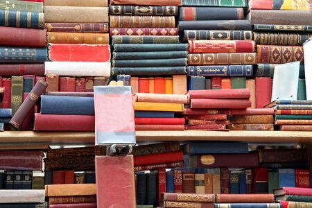 Big pile of old books on vintage market