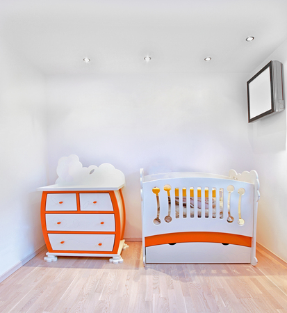 Detail of nursery room interior with small crib Stok Fotoğraf