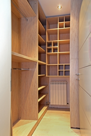 Empty walk in closet with wooden shelves photo