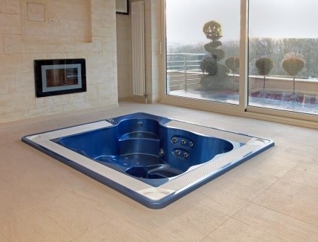 Large hot tub built in flor of room interior
