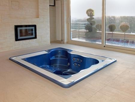 Large hot tub built in flor of room interior