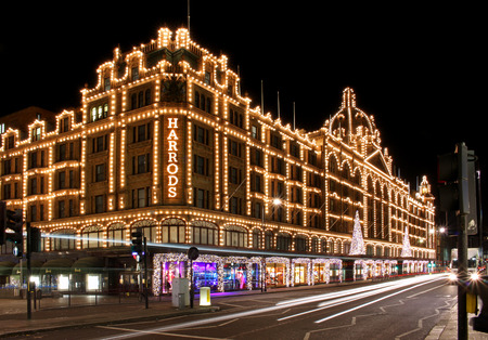 London, United Kingdom - November 24, 2013; Long exposure shot of Harrods department store in London during night with street traffic Editöryel