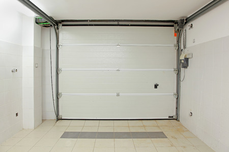 Private garage interior with closed door from inside