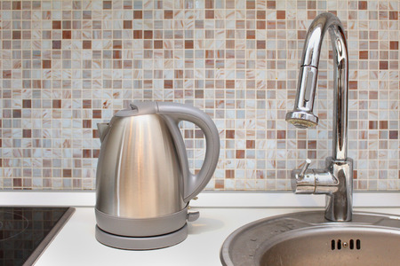 Silver kettle appliance on modern kitchen counter