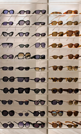 Large sunglasses selection on display in shop Stok Fotoğraf