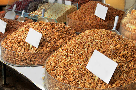 Healthy snack street market stall with mixed nuts photo