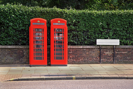 phonebooth: British red phone boots outside on street Stock Photo