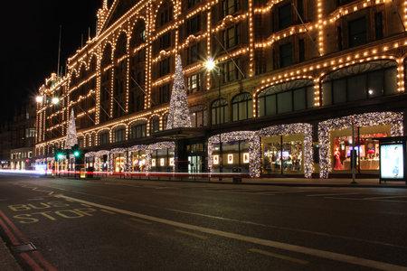 harrods: LONDON, UNITED KINGDOM - November 24; Brompton road in front of Harrods department store during night in London, UK - November 24, 2013; Brompton road in London in front of Harrods during night