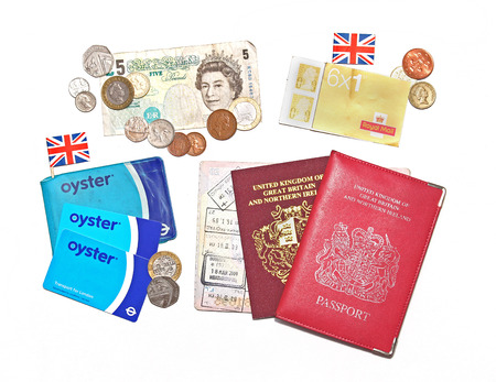 british people: LONDON, UNITED KINGDOM - JULY 28, 2014  Recognizable items used by British people daily, money British pounds, Royal mail postmarks, passport and Transport for London Oyster card used in public transport