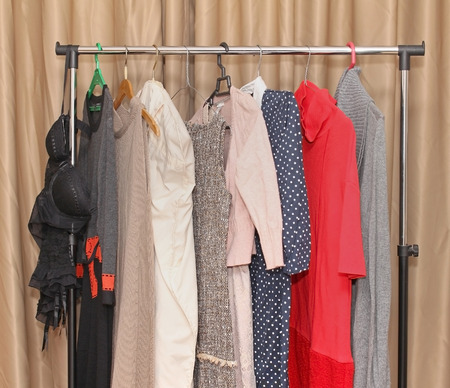 clothes rack: Fashionable modern female clothes hanging from rack Stock Photo