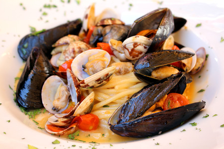 Fresh seafood pasta with shells and tomato