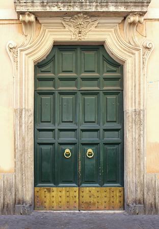 large doors: Large vintage wooden green door with gold details