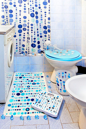 Small bathroom interior with blue dots theme decor photo