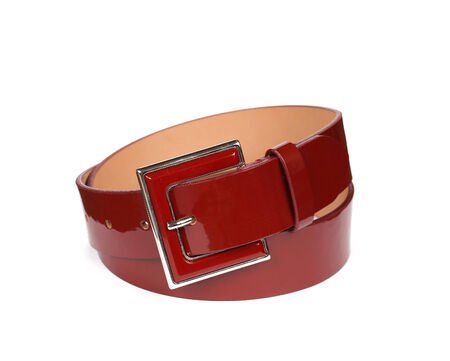 patent leather: Fashionable shiny red patent leather belt on white background Stock Photo