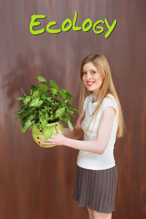 foundation problems: Young girl holding green plant supporting ecology movement Stock Photo
