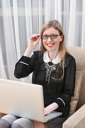 working from home: Young business woman working from home on laptop