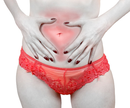 pms: Woman holding her bloated tummy in pain from PMS