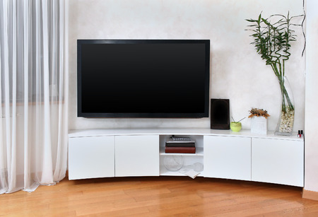 Large flat screen TV in modern interior living room Stock Photo