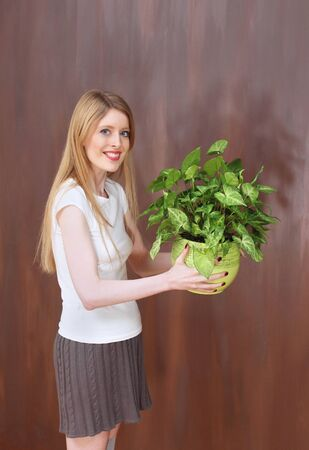 foundation problems: Young girl holding green plant supporting ecology Stock Photo