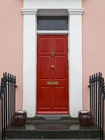 Red entrance front door on old house Stock Photo