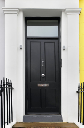 entrances: Black wooden closed entrance front door detail