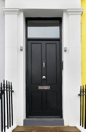 Black wooden closed entrance front door detail