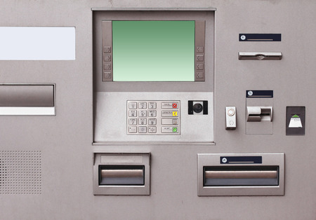 bank withdrawal: Contemporary bank cash machine with green screen Stock Photo