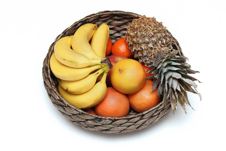 fruits in a basket: Fresh fruits inside rattan basket on white background Stock Photo