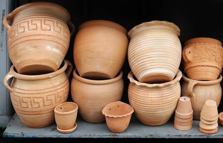 clay craft: Art and craft terracotta clay containers pile