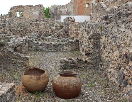 archeology: Ancient cracked pottery jars in old ruined archeology site