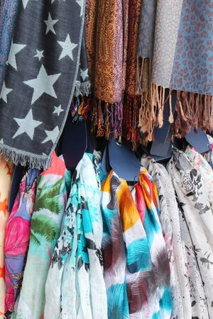 bufandas: Pile of fashionable textile scarves with colorful patterns
