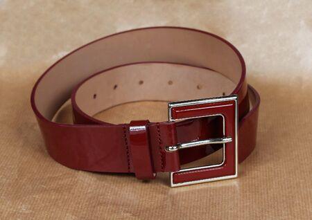 waistband: Shiny dark red patent leather belt accessory Stock Photo