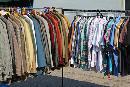 second hand: Second hand worn clothes sold on flea market Stock Photo