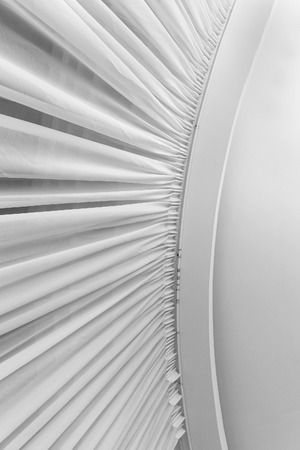 pleated: Pleated white material pattern on corner ceiling