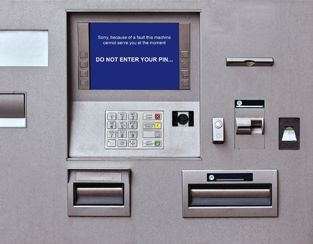 faulty: Banking machine with faulty warning sign on screen