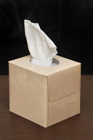 sniffles: Box of paper tissues with one sticking from the top