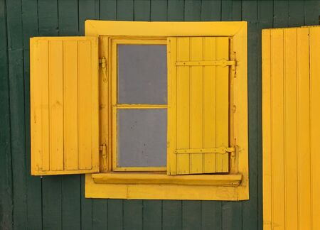 window shades: Old retro window with yellow wooden frame