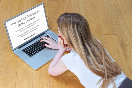 no person: Young girl looking at her laptop upset because of first world problem - loss of internet connection