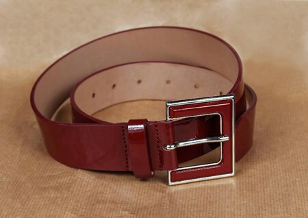 patent: Shiny dark red patent leather belt accessory Stock Photo