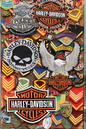 ATHENS, GREECE - MAY 02, 2015: Harley Davidson and other patches used by bikers stitched to their clothes representing motorbike lifestyle sold on vintage market. Harley-Davidson sustains a large brand community which keeps active through clubs and events