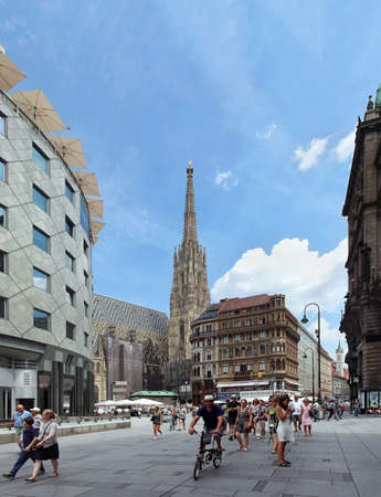 stephen: VIENNA, AUSTRIA - JULY 12, 2015; One of the most famous squares St. Stephen platz in Vienna, Austria - July 12, 2015: Tourists walking through St. Stephen platz in the Vienna city centre Editorial
