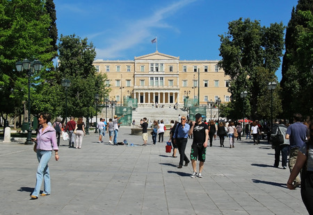 syntagma: ATHENS, GREECE - MAY 04, 2015; Famous Syntagma square with Greek parliament in Athens, Greece - May 04, 2015: Busy Syntagma square with people walking around and parliament building in the back