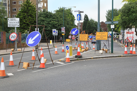 LONDON, UNITED KINGDOM - June 20: Traffic signs on the street in Westminster signaling diversion because of road works in London, UK - June 20, 2012; Road works in West End of London Imagens - 54389978