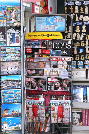 publications: ATHENS, GREECE - MAY 02, 2015; Newsstand with international magazine publications, souvenirs and postcards in Athens, Greece - May 02, 2015: Outdoor stand with postcards and souvenirs sold at city street