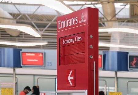 drop off: ATHENS, GREECE - May 05: Emirates airline drop off and check in at Athens International Airport Eleftherios Venizelos with Economy class sign in Athens, Greece - May 05, 2015; Large international airport departure hall before check in. Editorial